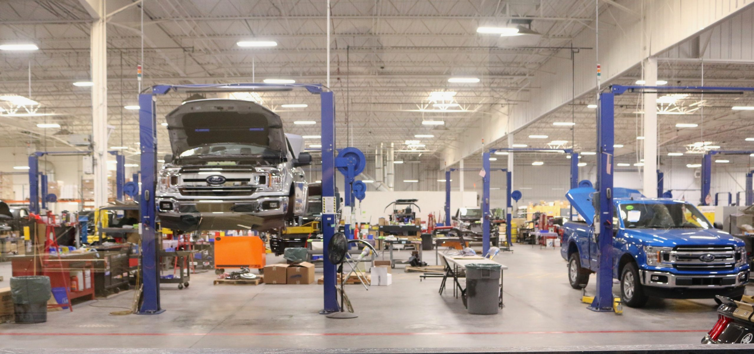 Cars in shop getting repaired